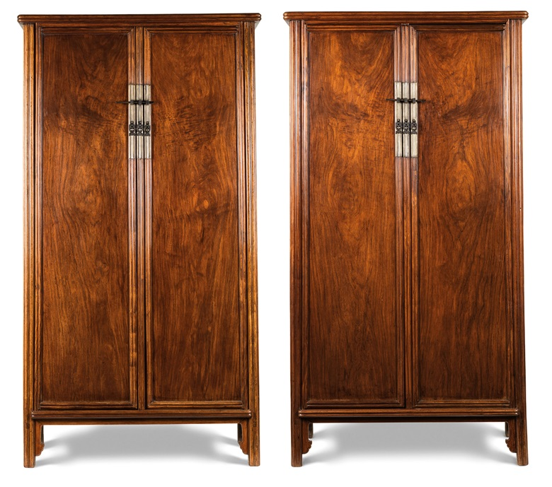 A fine large pair of huanghuali round-corner tapered cabinets, yuanjiaogui, Qing dynasty, 17th-18th century. 69¾  in (177.2  cm) high, 36½  in (92.7  cm) wide, 19½  in (49.5  cm) deep (each). Sold for HK$36,100,000 on 29 November 2017  at Christie's in Hong Kong