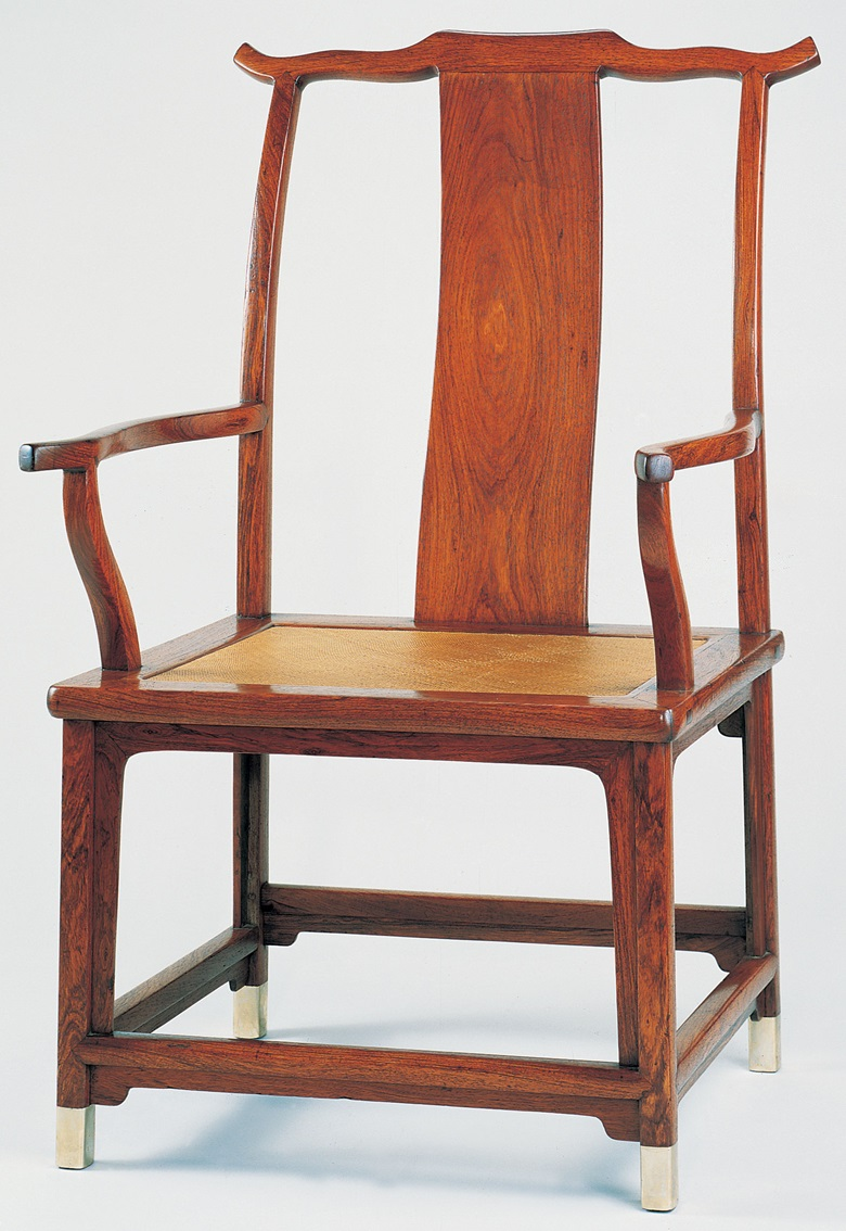 A large huanghuali yokeback armchair, Guanmaoyi, 17th century. Sold for $140,000 on 19 September 1996 at Christies in New York