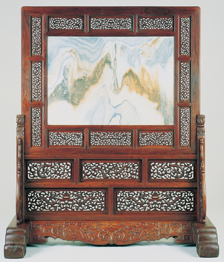 A large rare marble huanghuali and tielimu standing screen, zuopingfeng, 17th century. Sold for $1,102,500 on 19 September 1996 at Christies in New York