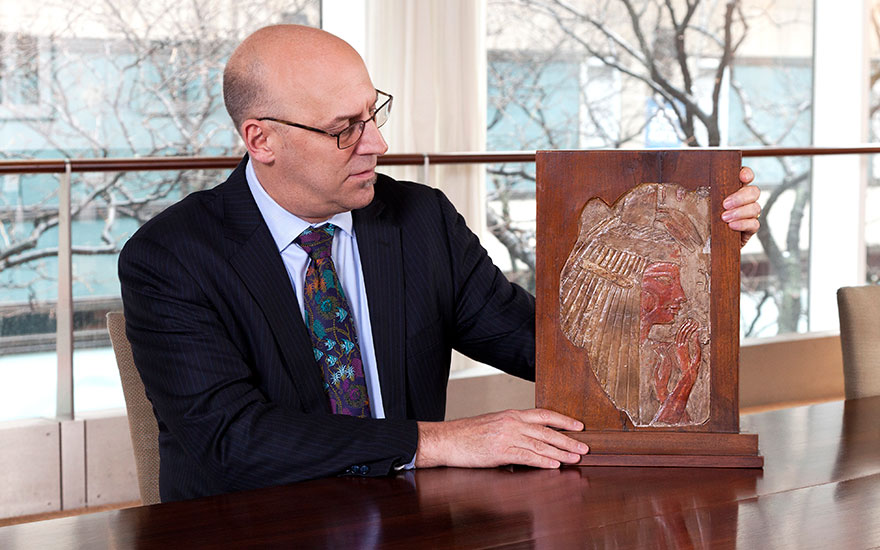 G. Max Bernheimer with an Egyptian bas-relief from circa 1400-1250 B.C.