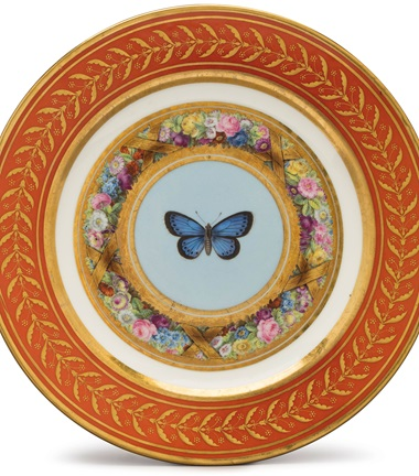 A plate with the service's rich, red borders, gilt with berry leaves