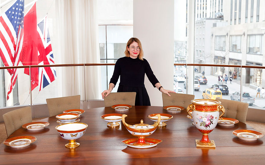 Christie's specialist Carleigh Queenth with pieces from the 'Marly Rouge' dessert service, from The Collection of Peggy and David Rockefeller