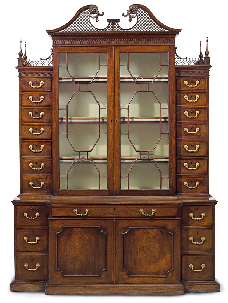 A George III mahogany breakfront secretaire cabinet in the manner of Thomas Chippendale, circa 1765. 95 in (241 cm) high; 68½ in (174 cm) wide, 21½ in (55 cm) deep. Estimate $50,000-80,000. This lot is offered in The Collection of Peggy and David Rockefeller in Spring 2018 at Christie's in New York