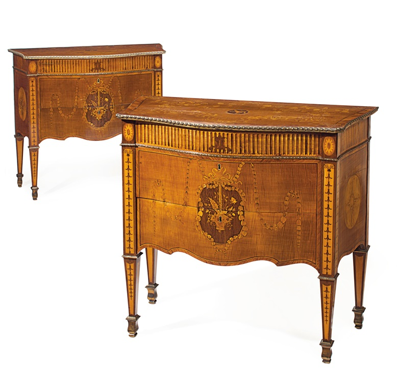 A pair of George III lacquered-brass mounted sycamore, satinwood, amaranth and tulipwood marquetry commodes, circa 1775. 35 in (89 cm) high; 38¾ in (98.5 cm) wide; 19¾ in (50 cm) deep. Estimate $60,000-100,000. This lot is offered in The Collection of Peggy and David Rockefeller in Spring 2018 at Christie's in New York