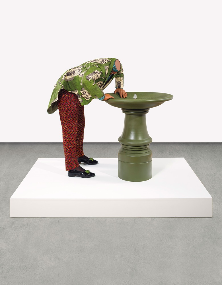 Yinka Shonibare MBE (b. 1962), Headless Man Trying to Drink. 58 x 72⅞ x 48⅛ in (147.3 x 185.1 x 122.2 cm). Estimate $50,000-70,000. This work is offered in the Post-War and Contemporary Art Sale on 1 March at Christie's in New York
