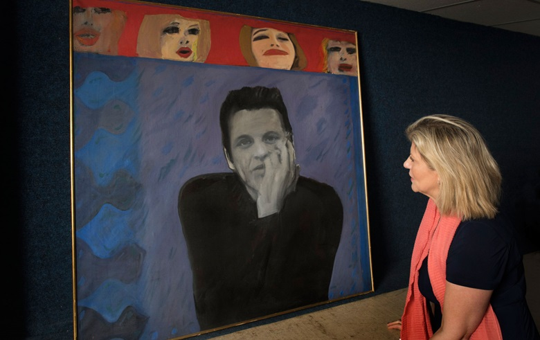 Rachel Hidderley, Christie's Senior Director of Modern British art, with Pauline Boty's Portrait of Derek Marlowe with Unknown Ladies