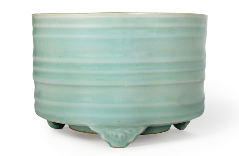 A longquan Celadon tripod censer, Southern Song dynasty (1127-1279). 5¾  in (14.7  cm)  diam, reticulated silver cover, Japanese wood box. Sold for $62,500 on 22 March 2018 at Christie's in New York