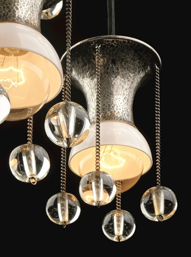 Josef Hoffmann (1870-1956), hanging chandelier, 1904. Hammered brass, nickel-plated with glass bowls. 150 x 50 cm (59 x 19.6 in). Courtesy Yves Macaux