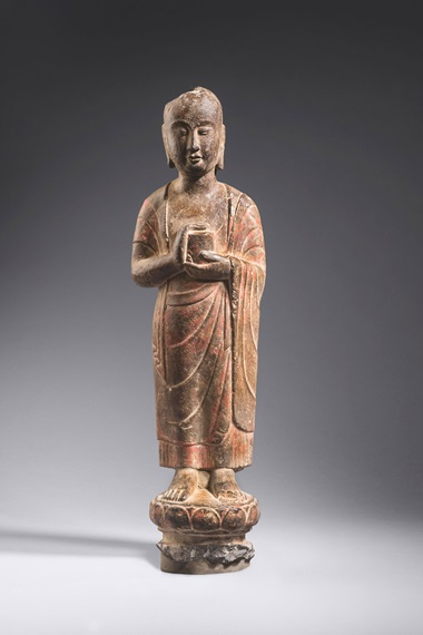 Limestone sculpture of a monk carrying a reliquary in both hands, China, Northern Qi dynasty, 550-577. Limestone. 50.5 cm (19.8 in). Courtesy Ben Janssens Oriental Art