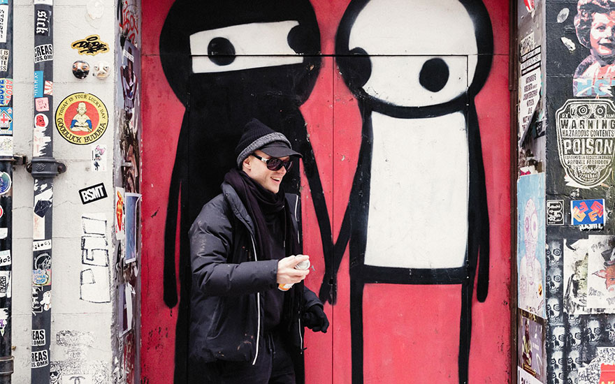Stik retouches A Couple Hold Hands in the Street in London's Brick Lane. Photography by Carol Sachs