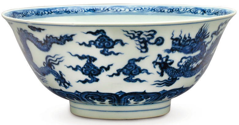 A rare anhua-decorated blue and white 'dragon' bowl, Xuande six-character mark in underglaze blue within a double circle and of the period (1426-1435). 8¼  in (21  cm)  diam. Estimate $100,000-150,000. This lot is offered in The Collection of David and Peggy Rockefeller Travel & Americana on 10 May at Christie's in New York