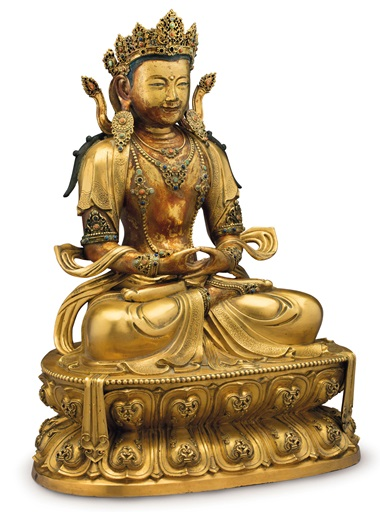 An imperial gilt-bronze figure of Amitayus, China, Kangxi Period (1662-1722). 16½  in (41.9  cm) high. Estimate $400,000-600,000. This lot is offered in The Collection of David and Peggy Rockefeller Travel & Americana on 10 May at Christie's in New York