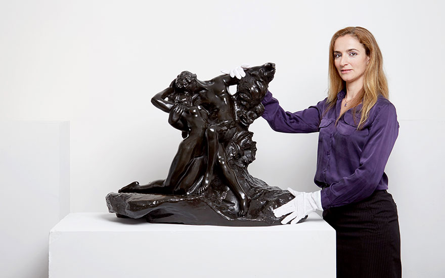 Valérie Hess, head of the Impressionist and Modern Art sale at Christie's Paris, with Auguste Rodin's Eternal Spring, offered in Art Impressionniste et Moderne on 23 March 2018  at