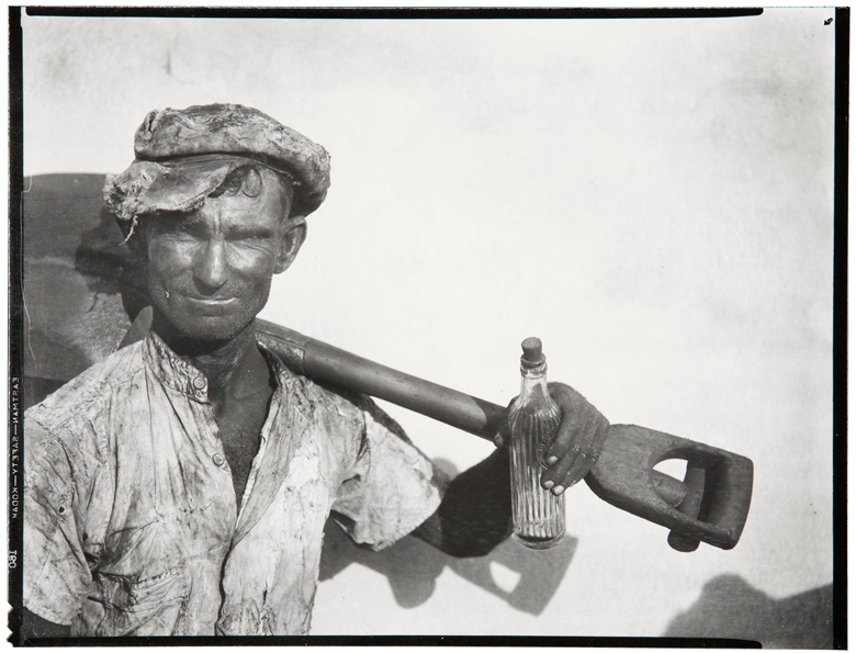 Walker Evans (1903-1975) Dockworker with Shovel and Bottle, Havana, 1933. Gelatin silver print, printed 1969-1970 by James Dow. This lot is offered in MoMA Walker Evans, 3-11 April 2018 at Christie's online