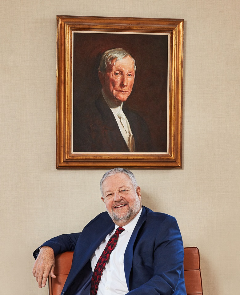 David Rockefeller, Jr. in front of a portrait of his great-grandfather John D. Rockefeller. Sr., by John Singer Sargent (private collection). Photo Christopher Sturman