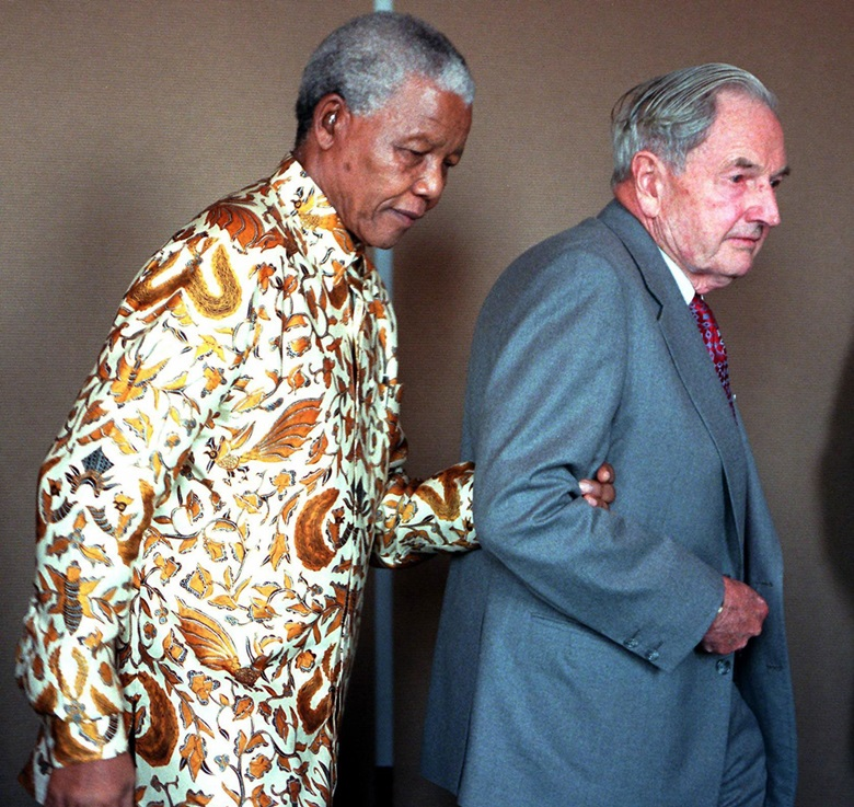 President Nelson Mandela of South Africa is led into a press conference by David Rockefeller after a breakfast meeting with business leaders in the Rockefeller Center, September 1998. Photo Henny Ray AbramsAFPGetty Images