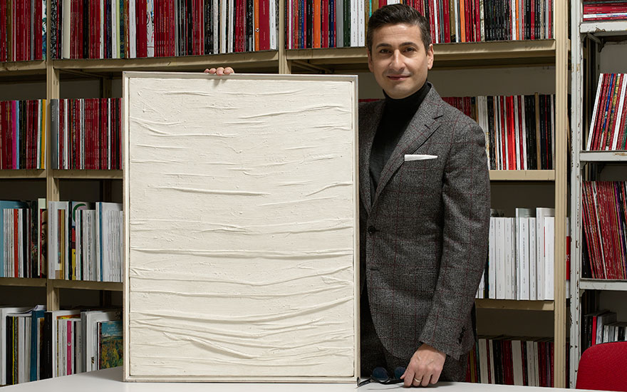 Renato Pennisi, Senior Specialist in Post-War and Contemporary Art in Italy, with Piero Manzoni's Achrome, which sold for a record €2,970,000 in the Milan Modern and Contemporary