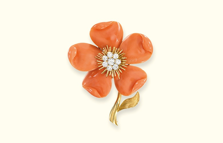 A coral and diamond Clematis clip brooch, by Van Cleef & Arpels. Sold for £6,875 on 11 June 2008 at Christie's London