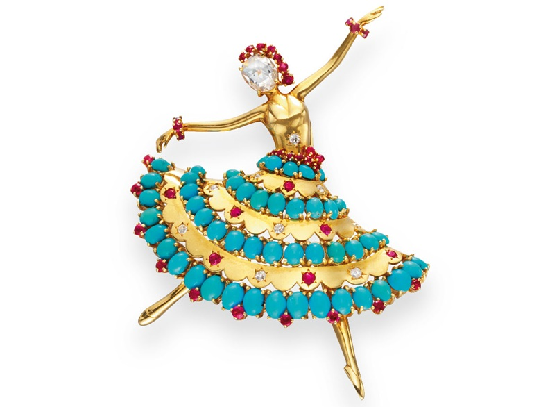 A gold, turquoise, diamond and ruby Ballerina brooch, by Van Cleef & Arpels. Sold for $80,500 on 22 April 2010 at Christie's in New York