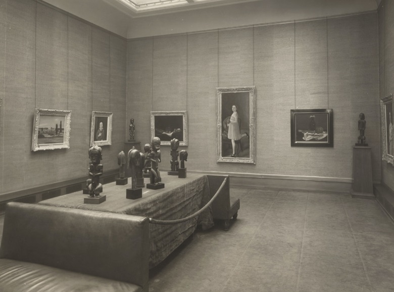 Installation view of the exhibition dedicated to André Derain, featuring the Fang sculpture, organised by Paul Guillaume at the Durand-Ruel Galleries in New York, 1933. The presence of this Fang figure in the exhibition was recently rediscovered in an astonishing 2017 recreation of the 1933 show by Bernard de Grunne at Almine Rech Gallery. The present statue stands on the end of the table