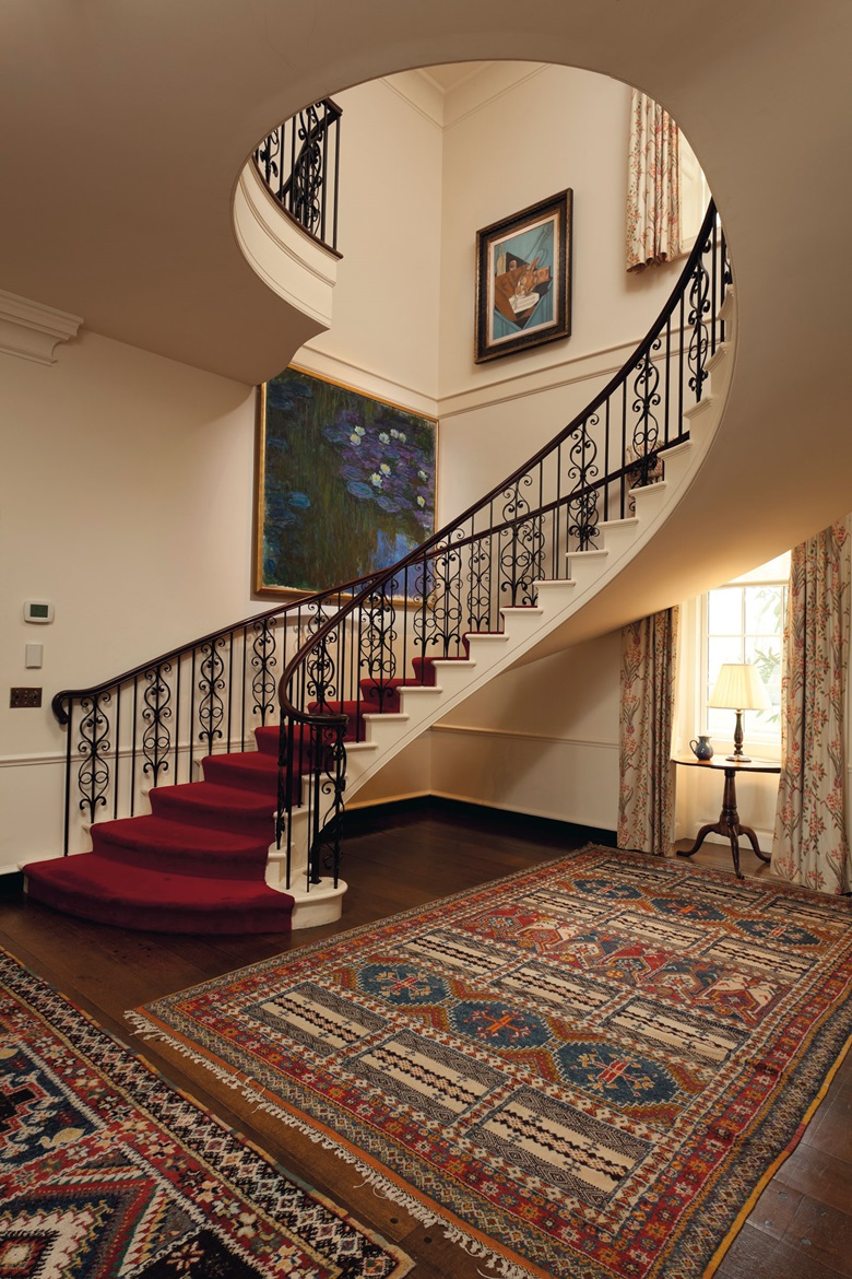 The stunning Monet in the stairwell of the Hudson Pines home of Peggy and David Rockefeller