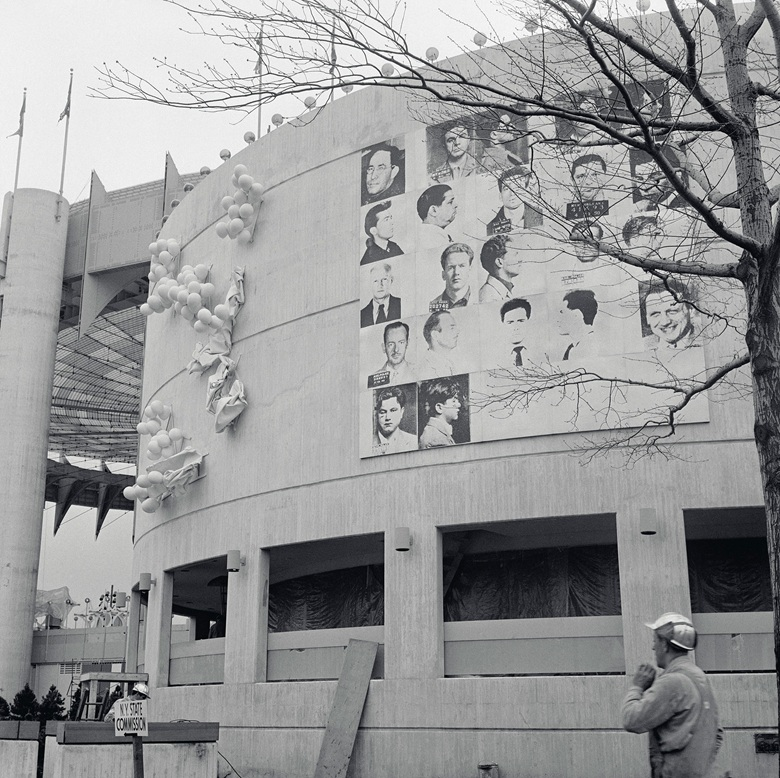 Installation view, Andy Warhol, Thirteen Most Wanted Men, 1964, New York State Pavilion, New York World's Fair, 1964. Photo Bettmann  Contributor  Getty Images. Artwork © 2018 The Andy Warhol Foundation for the Visual Arts, Inc.  Licensed by Artists Rights Society (ARS)