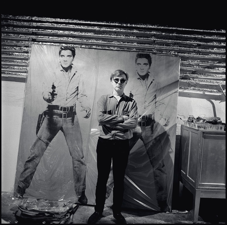 Andy Warhol in his New York studio with Double Elvis, circa 1964 (detail). Photo © Bruce DavidsonMagnum Photos. Artwork © 2018 The Andy Warhol Foundation for the Visual Arts, Inc.  Licensed by Artists Rights Society (ARS)