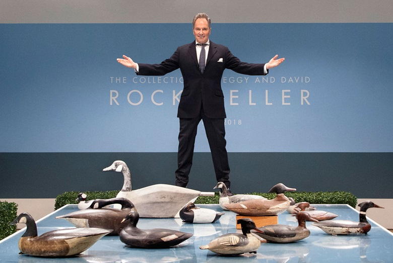 Lee Mindel with some of the Rockefellers collection of duck decoys.