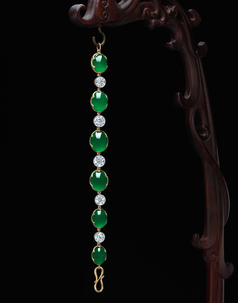 A superb jadeite and diamond bracelet. Designed as a line of six oval jadeite cabochons, alternating with circular-cut diamond collets, mounted in gold, largest cabochon approximately 14.9 x 12.9 x 5.9 mm, bracelet 18.2 cm. Sold for HK$15,040,000 on 31 May 2016 — a world auction record for a jadeite bracelet