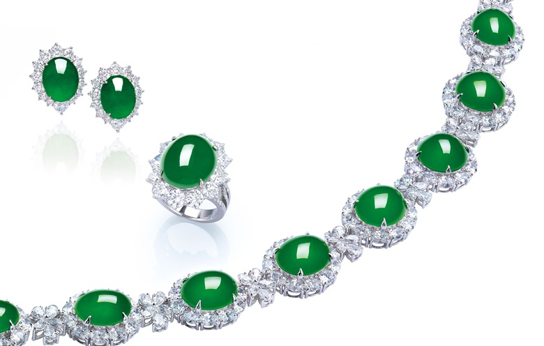 A suite of jadeite and diamond jewellery. Comprising a necklace, set with 15 oval jadeite cabochons, each within an oval-shaped diamond surround, to the pear and marquise-cut diamond floral spacers, a ring and a pair of earrings en suite, mounted in gold, largest cabochon approximately 17.8 x 15.2 x 7.2 mm, necklace 37 cm, ring size 6, ear pendants 2.4 cm. Sold for HK$24,060,000 on 29 November
