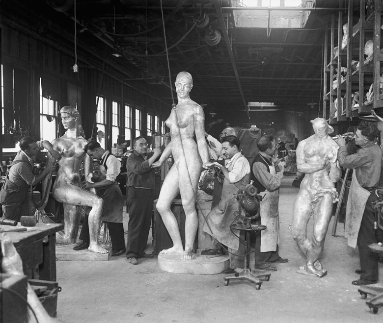 At Roman Bronze Works, New York. Staff working on sculptures for Rockefeller Center. From left William Zorach, Spirit of the Dance, Robert Laurent, Goose Girl, and Gwen Lux, Eve. Photo Getty Images. Artwork © William Zorach, LLC