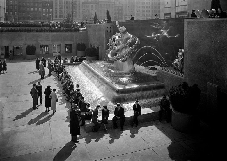 Looking down on the fountain featuring Youth, Prometheus and Maiden by Paul Manship, 1931, at RCA Building, Rockefeller Center. Photo by Samuel H. Gottscho 1934The Museum of the City of New YorkArt Resource, NY. Artworks © Estate of Paul Manship