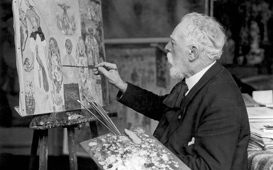 James Ensor photographed while painting in his studio in Ostend, 1933. Photo Spaarnestad PhotoBridgeman Images