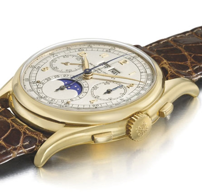 A unique and historically important 18K gold perpetual calendar chronograph Patek Philippe wristwatch with moon phases and tonneau-shaped case, 1943. 37.6  mm  diameter. Sold for CHF 6,259,000 on 10 May 2010 at Christie's in Geneva