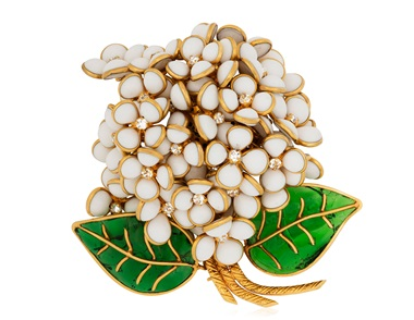 Chanel white and green poured glass and rhinestone flower brooch. Sold for $1,625 on 14 Jun 2018, Online