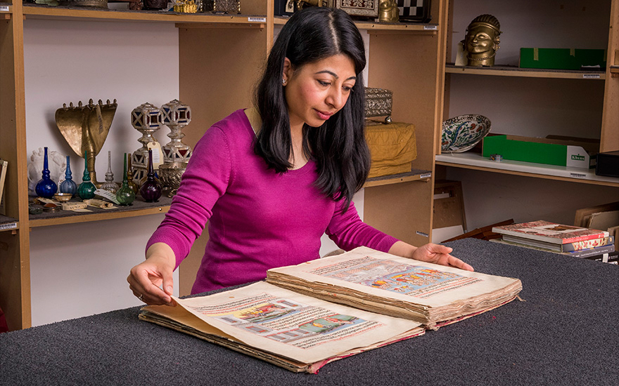 Christies Indian art specialist Rukmani Rathore with an 18th-century copy of the Hindu Ramayana manuscript
