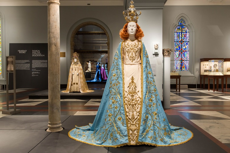 In the Medieval Europe Gallery. In the foreground, Riccardo Tisci, the Poor Benedettine Cassinesi Nuns of Lecce Statuary Vestment for the Madonna Delle Grazie, 2015 (original design, 1950). In the background Yves Saint Laurent, statuary vestment for the Virgin of El Rocío, c. 1985. Image © The Metropolitan Museum of Art