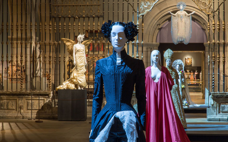 Gallery view in the Medieval Sculpture Hall. From the front Alexander McQueen for House of Givenchy, evening ensemble, springsummer 1999; Pierpaolo Piccioli for Valentino, evening dress, autumnwinter