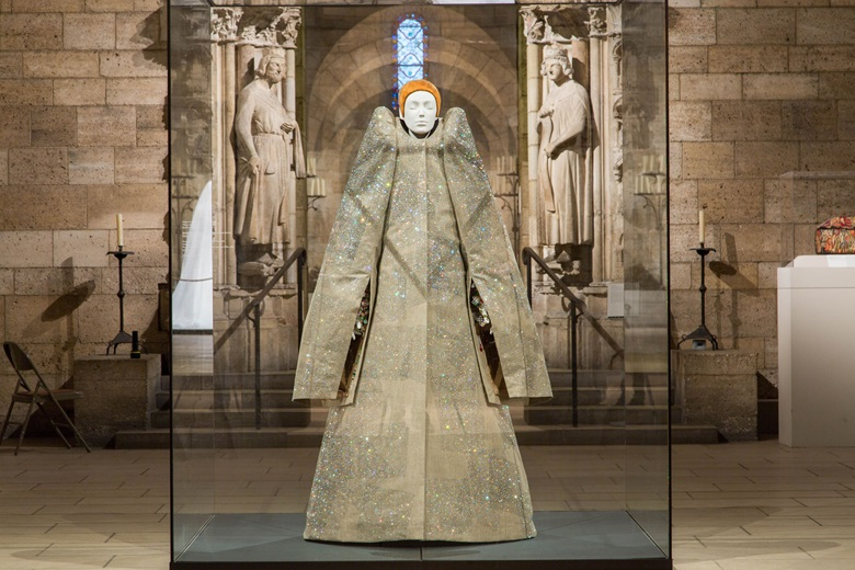 An ensemble by Viktor Horsting and Rolf Snoeren for Viktor & Rolf, from their autumnwinter 1999-2000 haute couture collection, in the Romanesque Hall. Image © The Metropolitan Museum of Art