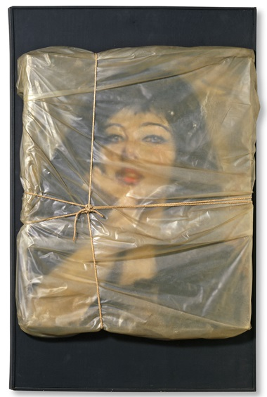 Christo, Wrapped Portrait of Jeanne-Claude, 1963. Oil on canvas portrait by Christo Javacheff, wrapped with polyethylene and rope by Christo, mounted on black wooden board. 30⅞ x 20⅛ x 2 in (78.5 x 51.2 x 5 cm). Collection David C. Copley (promised gift to the Museum of Contemporary Art, San Diego, USA). Photo Christian Baur. © 1963 Christo