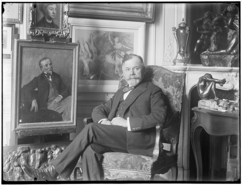 Georges Viar, collector and friend of Sisley, Monet, Renoir, Degas, Picasso and Vuillard, beneath a Degas painting in a white frame. Photo by Francois Antoine Vizzavona. Photo © RMN-Grand Palais  Frank Raux