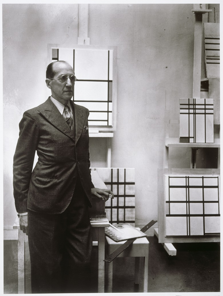 Piet Mondrian surrounded by his frameless works. Photo by Rogi André (Rosa Klein). Photo © Centre Pompidou, MNAM-CCI, Dist. RMN-Grand Palais  Georges Meguerditchian