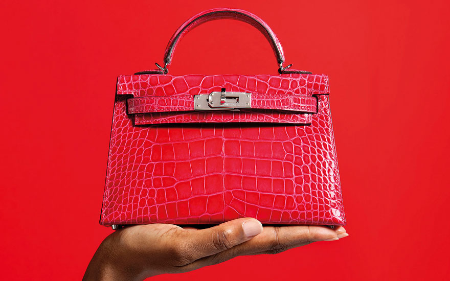 A shiny rose extrême alligator sellier Mini Kelly 20 II with palladium hardware, Hermès, 2017. 20 w x 12 h x 6 d cm. Estimate £20,000-25,000. Offered in Handbags &