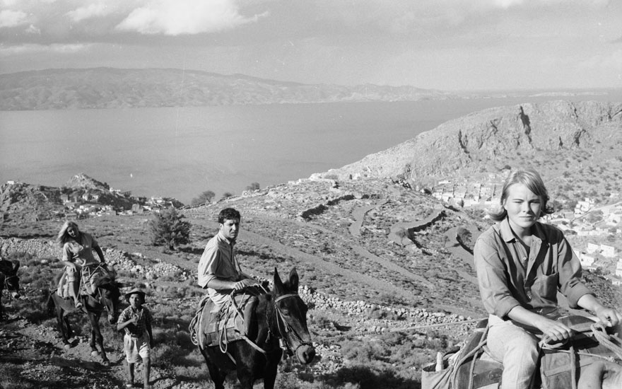 Marianne Ihlen (right) and Leonard Cohen (middle) during a trek around Hydra, Greece, October 1960. Photo by James BurkeThe LIFE Picture CollectionGetty Images