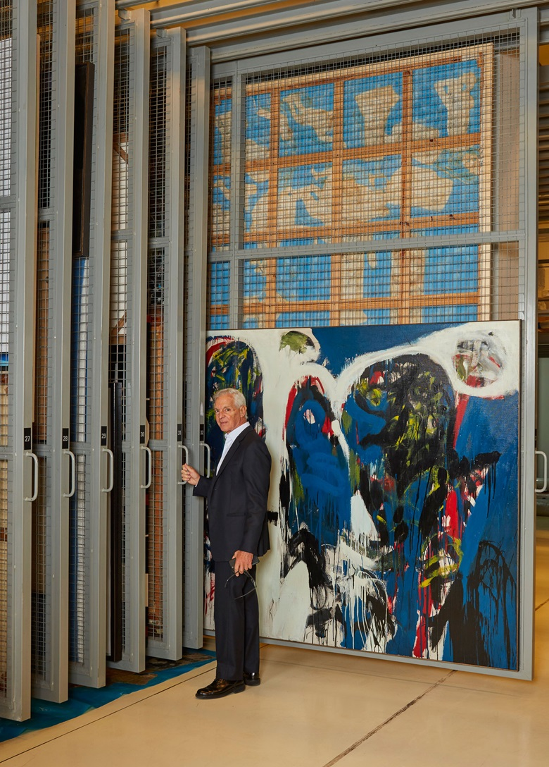 Eduardo Costantini behind the scenes at MALBA and alongside Ernesto Deira, Desde Adán y Eva No.5 (1963) Colección Malba. Oil and enamel on canvas, 1963, 195 x 260 cm © Ernesto Deira. Photo by Christopher Sturman