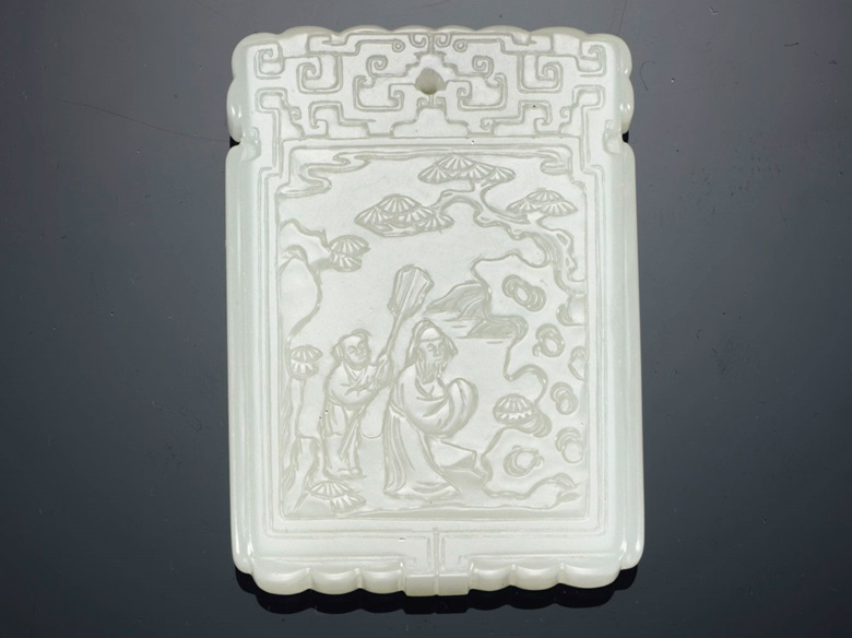 A white jade rectangular pendant plaque, 18th century. 1⅞ in (4.8 cm) high. Lizzadro Collection, Chicago, Illinois, acquired prior to 1960. Estimate $20,000-30,000. Offered in Fine Chinese Jade Carvings from Private Collections on 13 September at Christie's in New York