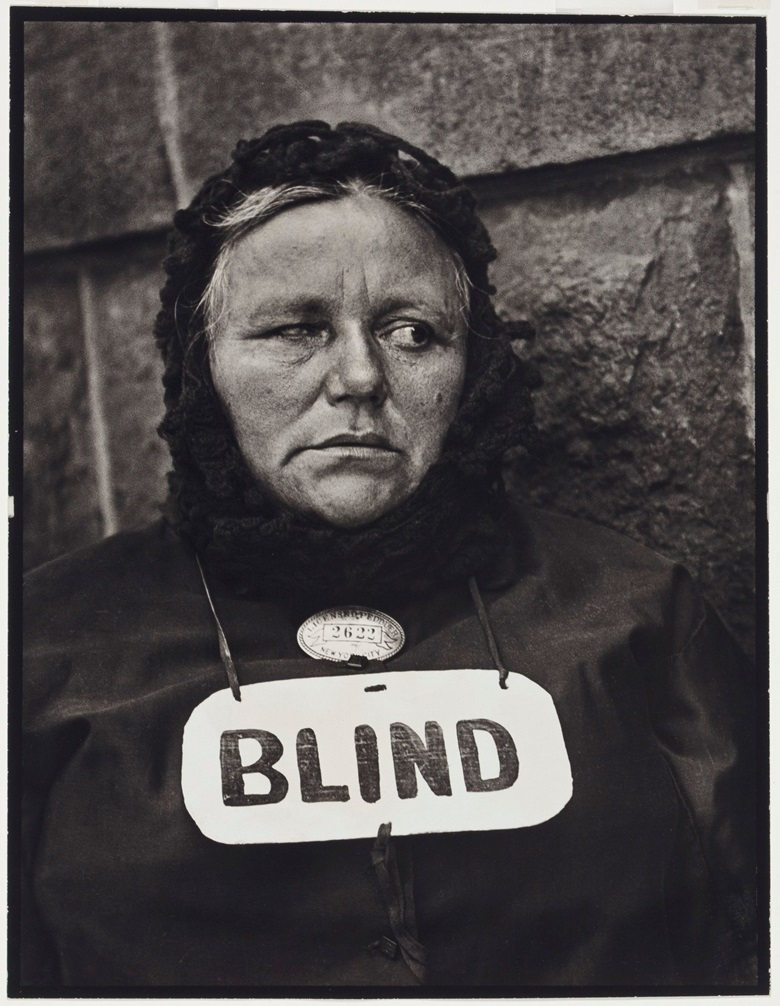 Paul Strand (1890-1976), Blind Woman, New York, 1916. Gelatin silver print, printed circa 1950. Image 13 x 9¾ in (33 x 24.8 cm); sheetflush mount 13⅜ x 10¼ in (33.9 x 26 cm). Estimate $70,000-100,000. This lot is offered in An American Journey The Diann G. and Thomas A. Mann Collection of Photographic Masterworks on 4 and 5 October at Christie's in New York