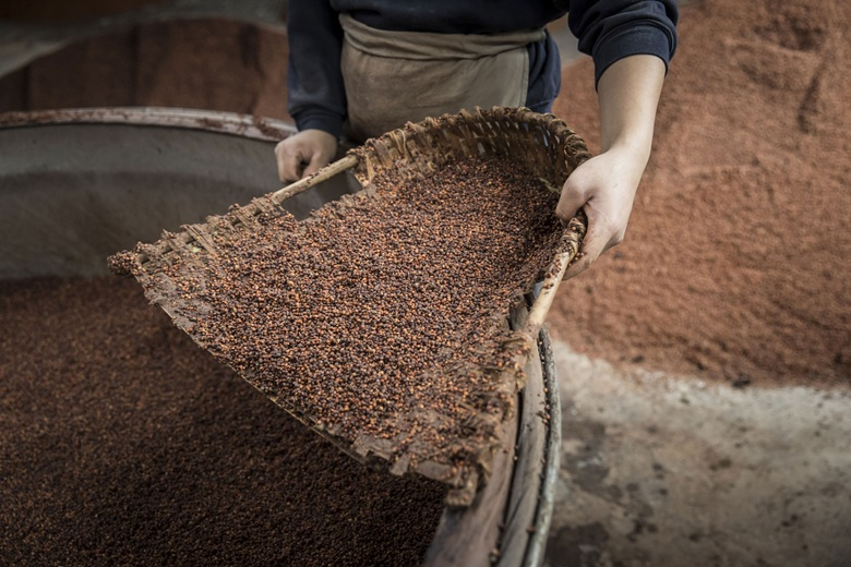 A	wicker	scoop filled with red sorghum, the key ingredient in the making of Maotai. Photo	Qilai	ShenBloomberg	via	Getty	Images