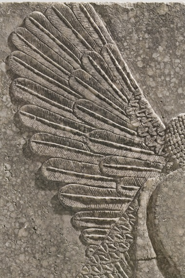 The wings of the apkullu, or genius, are exquisitely detailed