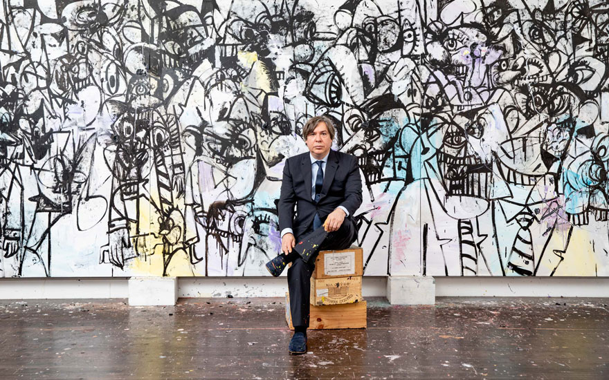 George Condo sitting in front of Collusion, 2017 © ARS, NY and DACS, London 2018. Photo Bill Gentle